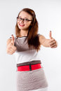 Smiling brunette woman in glasses signaling ok attractive girl shows big thumbs up gesture over white background Stock Image