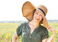 Smiling brunette woman in hat Stock Photography