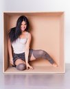 Smiling brunette woman in leg warmers in box Stock Image