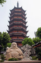 Smiling buddha statue in front of a distorted ruigang pagodda s suzhou jiangsu provine china Royalty Free Stock Photo