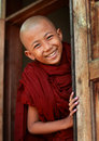 Smiling buddhist novice burmese in a teak monastery in mandalay myanmar Stock Photos