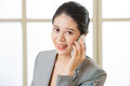 Smiling Business asian Woman talking on a Mobile phone Royalty Free Stock Photo
