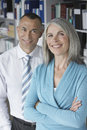 Smiling business couple in office portrait of a middle aged Royalty Free Stock Images