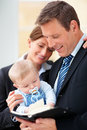 Smiling business couple with their cute baby Stock Image