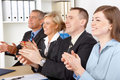 Smiling business group clapping hands Royalty Free Stock Photo