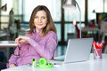 Smiling Business Lady in casual clothing sitting at Office Table Royalty Free Stock Photo