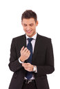Smiling business man buttoning his sleeve Royalty Free Stock Photos