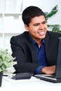 Smiling business man executive using a computer Royalty Free Stock Photos