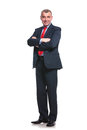 Smiling business man with folded arms full length picture of a mid aged his crossed isolated on a white background Royalty Free Stock Photos