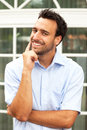 Smiling business man outdoors in front of his office Royalty Free Stock Photo