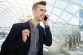 Smiling business man on phone walking by turnstile Royalty Free Stock Photo
