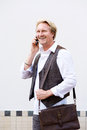 Smiling business man talking on cell phone Royalty Free Stock Photo