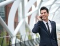 Smiling business man talking on mobile phone in the city close up portrait of a Stock Image