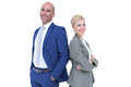 Smiling business people back to back with arms crossed Royalty Free Stock Images