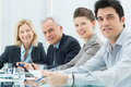 Smiling business people in conference room Royalty Free Stock Image