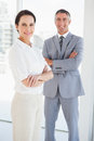Smiling business people with folded arms Royalty Free Stock Photo