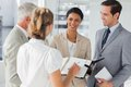 Smiling business people making an appointment in the workplace Royalty Free Stock Photography