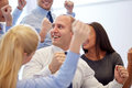 Smiling business people meeting in office teamwork and success concept team making triumph gesture Royalty Free Stock Photos