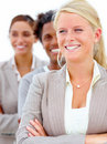 Smiling business people standing with arms folded Stock Photos