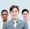 Smiling business people standing with folded arms Royalty Free Stock Images