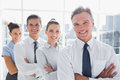 Smiling business people standing together in line a modern office Stock Photography