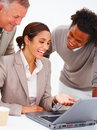 Smiling business people using laptop isolated Royalty Free Stock Image