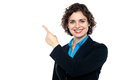 Smiling business professional pointing away Royalty Free Stock Images