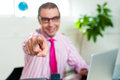 Smiling business professional pointing you out Royalty Free Stock Images