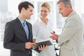 Smiling business team going over documents in the office Royalty Free Stock Photography