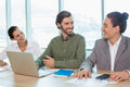 Smiling business team interacting with each other in conference room Royalty Free Stock Photo