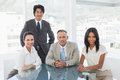 Smiling business team in an office Royalty Free Stock Photo
