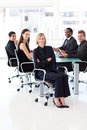 Smiling business team sitting in a presentation Stock Photo