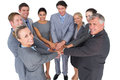 Smiling business team standing in circle hands together on white background Royalty Free Stock Photo