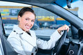 Smiling business woman in a car Stock Photos