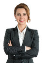 Smiling business woman with folded hands against white background toothy smile crossed arms Royalty Free Stock Photo
