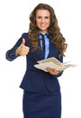 Smiling business woman holding book and showing thumbs up isolated on white Stock Photography