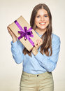 Smiling business woman holding gift box
