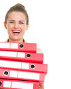 Smiling business woman holding stack of folders isolated on white Stock Images