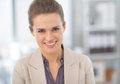 Smiling business woman in modern office portrait of Stock Photography