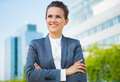 Smiling business woman in office district looking into distance Royalty Free Stock Photo