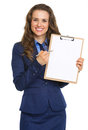 Smiling business woman pointing in blank clipboard isolated on white Royalty Free Stock Photo