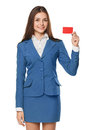 Smiling business woman showing blank credit card in blue suit, isolated over white background Royalty Free Stock Photo