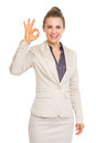 Smiling business woman showing ok gesture isolated on white Royalty Free Stock Image