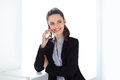Smiling business woman speaking on mobile phone Royalty Free Stock Photo