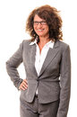 Smiling business woman standing with hand on waist portrait of a in glasses isolated against white background Royalty Free Stock Photos