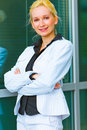 Smiling business woman standing near office Royalty Free Stock Photography