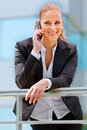 Smiling business woman talking on mobile Stock Photography