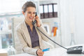 Smiling business woman talking phone in office Royalty Free Stock Photo