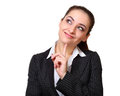 Smiling business woman thinking with finger under face and looking isolated on white Royalty Free Stock Photography