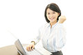 Smiling business woman using laptop the female office worker who poses happily Stock Photo